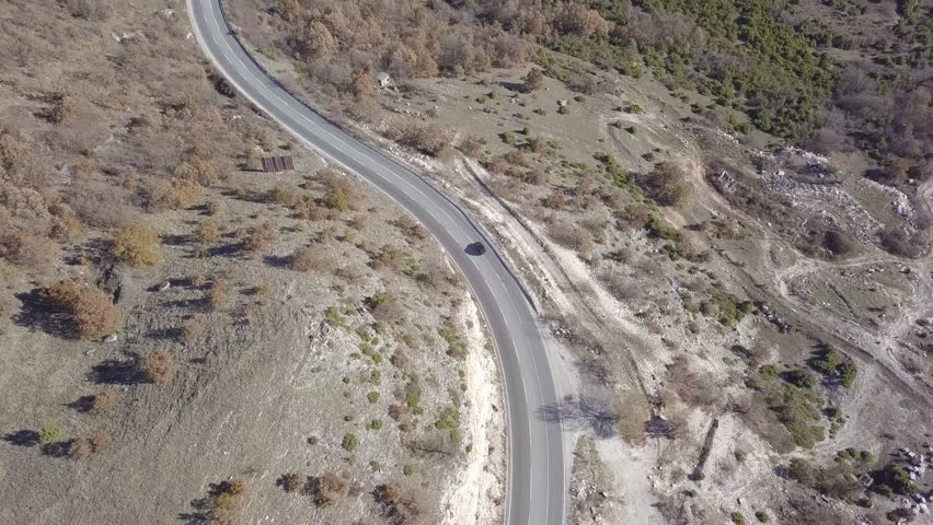 Aerial view of a cars driving on a curvy mountain road on cloudy day    Shutterstock HD Video #34932355