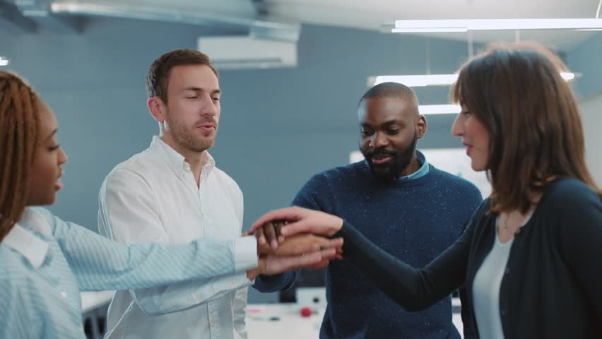 Group of successful lawyers from prestigious law firm winning important deal. Four people smiling, laughing. Indoors. | Shutterstock HD Video #34937701