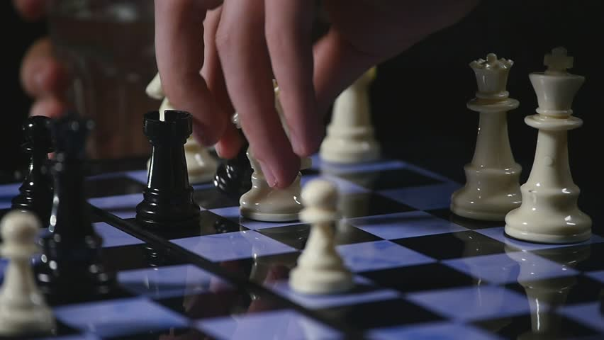 Chess boards and chess pieces game on black background | Shutterstock HD Video #34948846