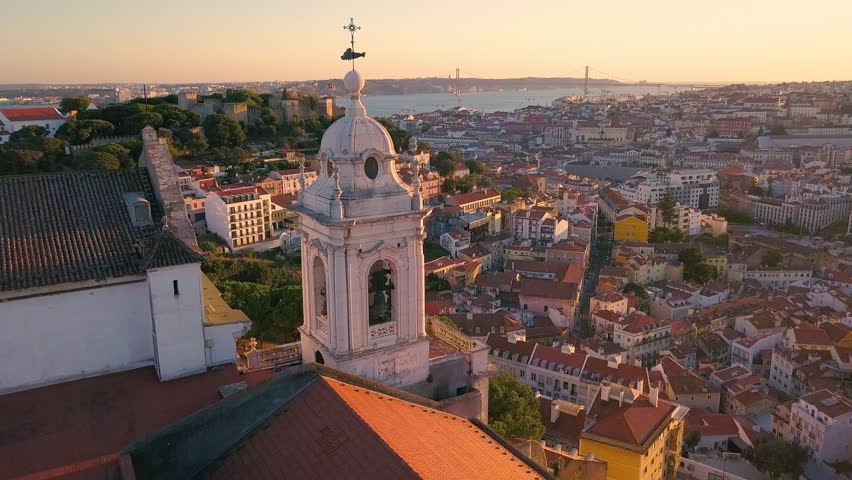 Lisbon Portugal Aerial timelapse Tower of the church Sunset sky 4k