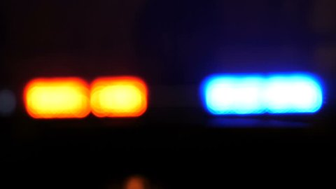 Police lights flashing at night downtown