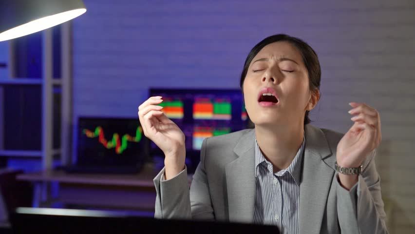 Slow motion of frustrated young stock trader woman meets the problem while sitting at her working place in the office. | Shutterstock HD Video #34982581