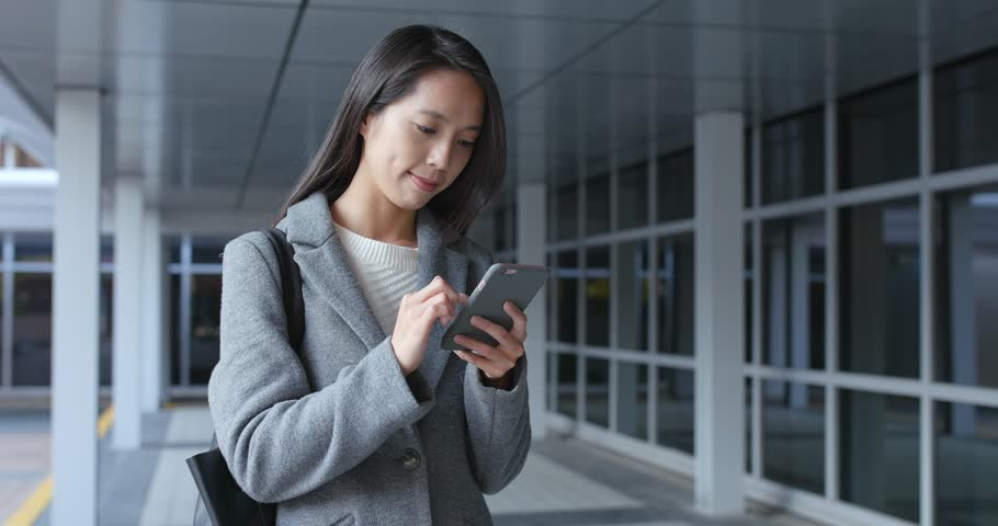 Woman working on mobile phone at outdoor | Shutterstock HD Video #35003008