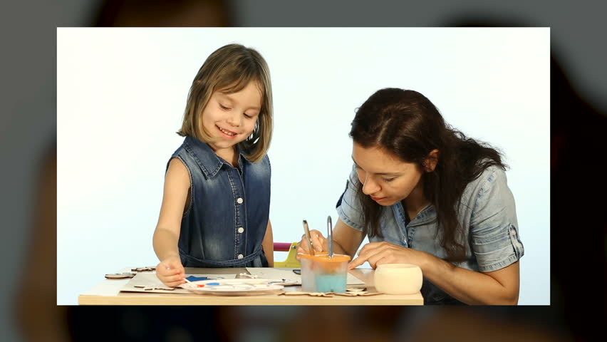 Family concept, mom and child drawing. Christmas eve. Handy craft montage representatives on 3D cube.  | Shutterstock HD Video #35013370