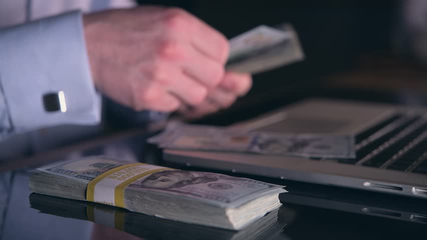 Caucasian Businessman Counting Hard Earned Money on His Glassy Office Desk | Shutterstock HD Video #35018716