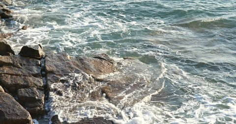 Sea wave and rock