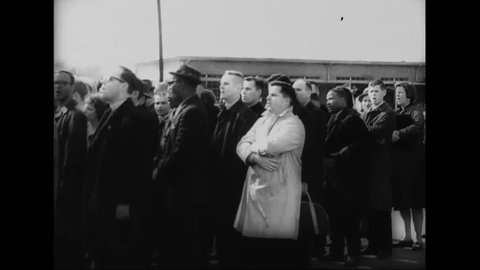 CIRCA - 1965 - Protesters, led by Martin Luther King Jr., pray during a tense stand off at the Edmund Pettus Bridge in Selma, Alabama.