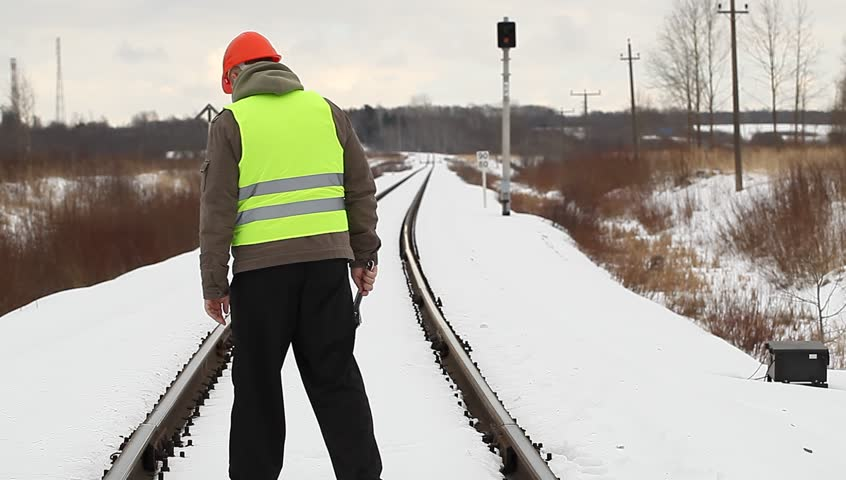 Railroad worker take railway safety inspection
