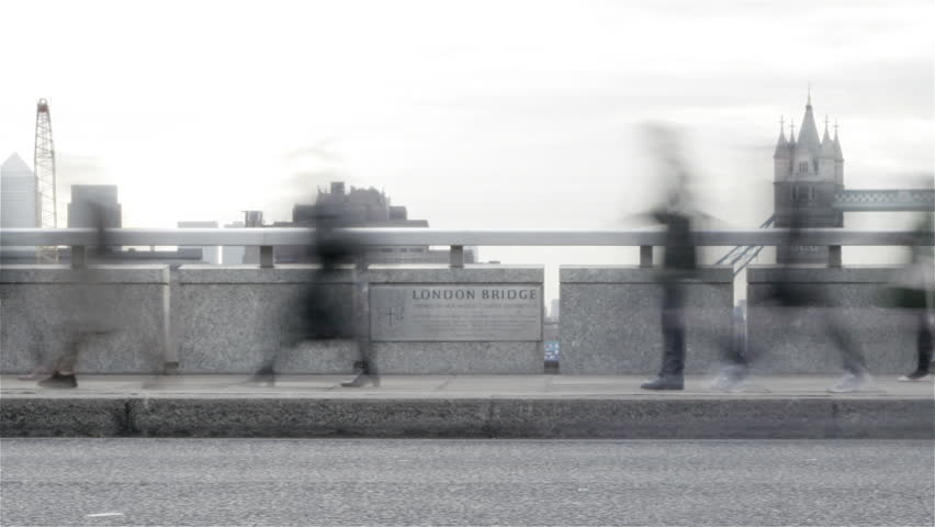 Time lapse: London Rush Hour. Time lapse footage of rush hour commuters on their way to the office on London Bridge with a slow pan revealing the iconic Tower Bridge in the background.