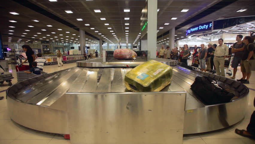 BANGKOK - MARCH 14. Timelapse of passengers at baggage reclaim in Bangkok airport on March 14, 2012. Suvarnabhumi airport is world's 4th largest single-building airport terminal.