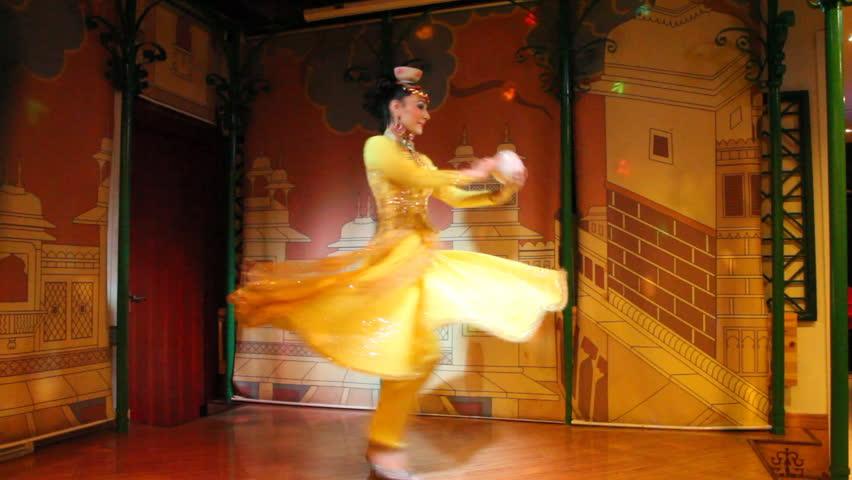 SHANGHAI - DECEMBER 21: Uyghur dancers from XinJiang province perform folk dance