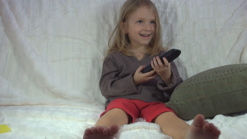 Child Watching TV, Little Girl Having Fun on the Couch, Children