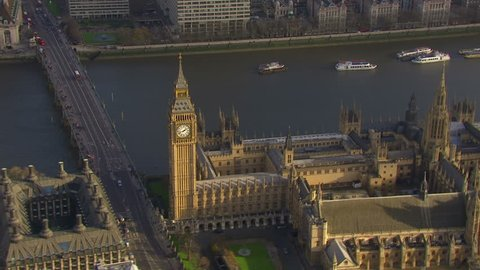 Aerial view flying over the Houses of Parliament and the Westminster bridge in London, England on a bright and sunny autumn day. The bridge joins the city of Westminster and the borough of Lambeth.