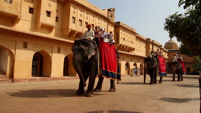 JAIPUR, INDIA - NOVEMBER 19, 2012: Tourists on elephants in fort Jaipur, India, 19 nov 2012