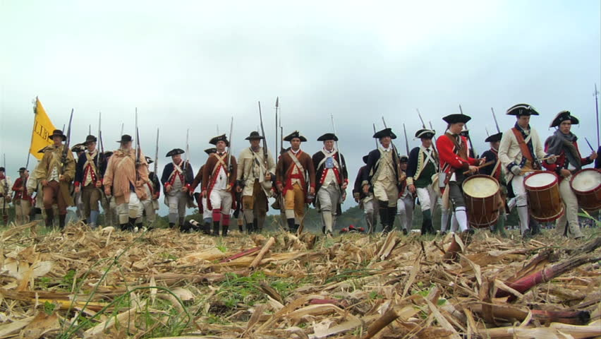 VIRGINIA - OCTOBER 2009 - large-scale, epic American Revolutionary War anniversary reenactment -- in the middle of battle.  Continental Army in line of battle marches forward toward camera.