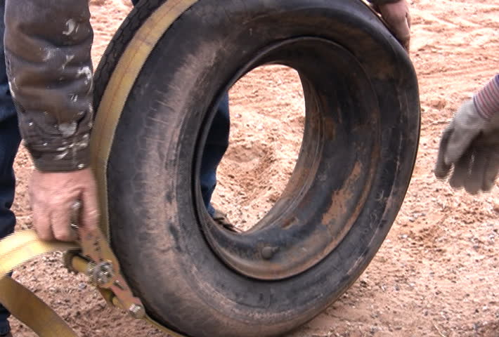 Struggling to inflate an old tire.