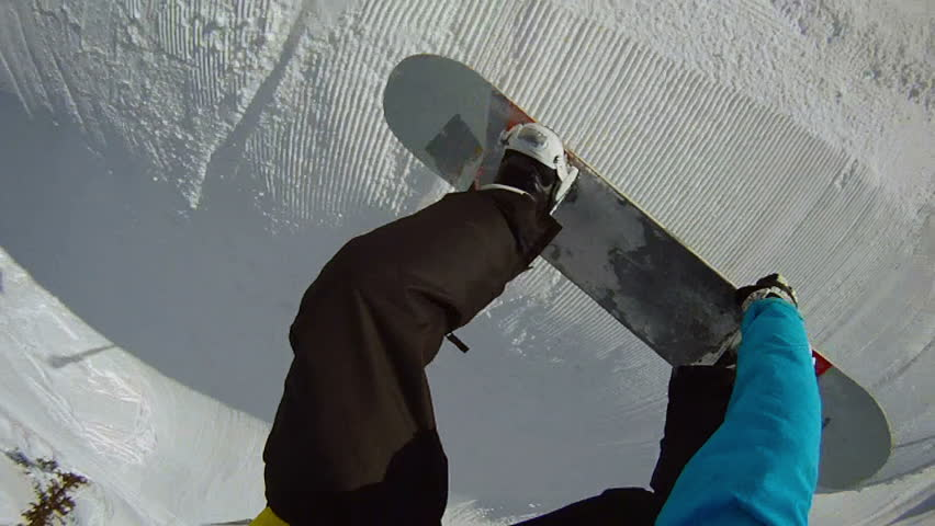 FIRST PERSON VIEW: snowboarder jumps frontside 360 | Shutterstock HD Video #3610097