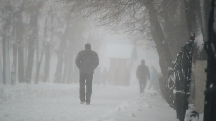 people walk on snowy road