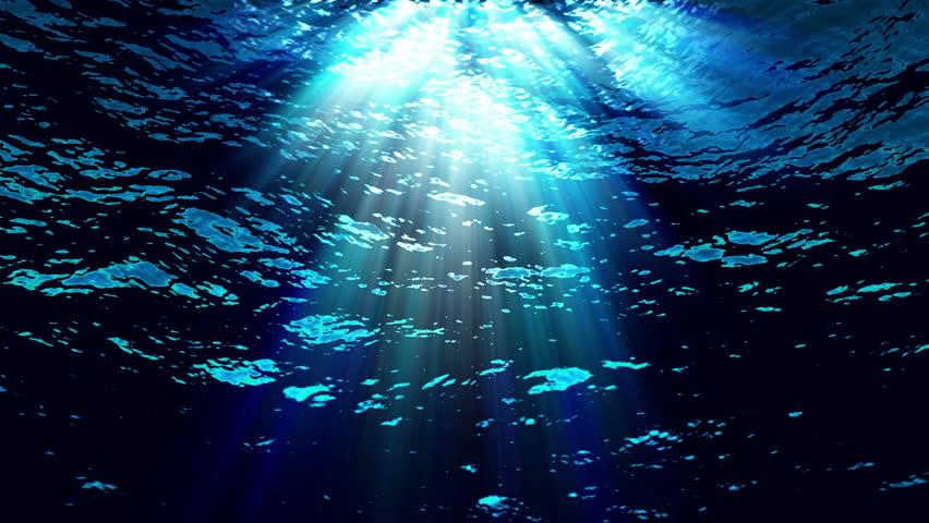 HD - Underwater light filters down through blue water (Loop).