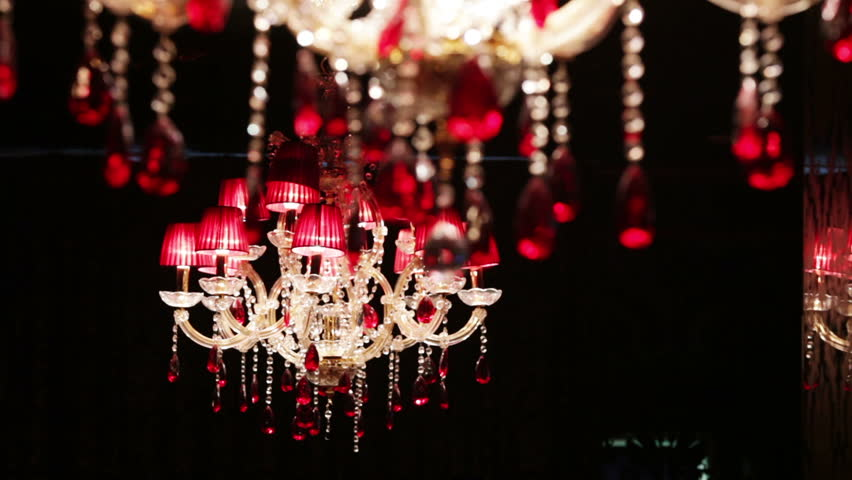 Moves focus from one to the other crystal chandelier.