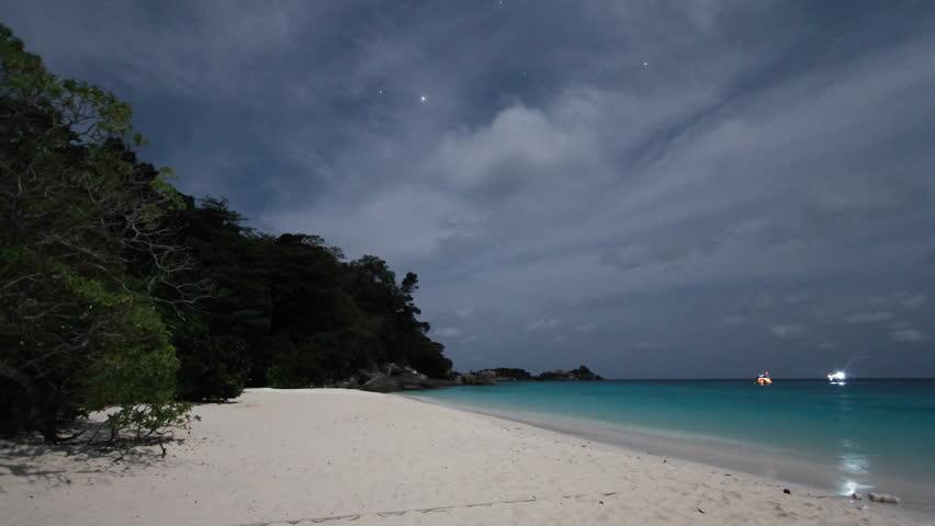 Similan island of Thailand beach at moonlit night, time lapse.