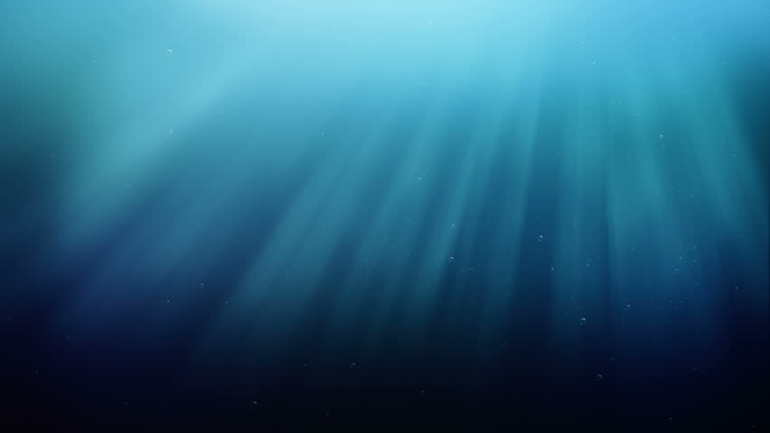 Ocean waves, underwater with light rays.