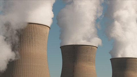 Hyperboloid cooling towers emit steam at the Bruce Mansfield Power Station, a coal-fired power station owned and operated by FirstEnergy on the Ohio River near Shippingport, Pennsylvania.