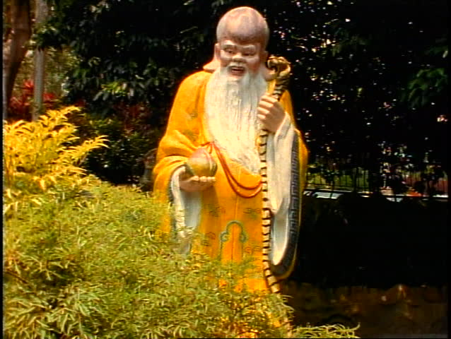 Singapore Tiger Balm Gardens, wise old man in yellow gown, tilt up