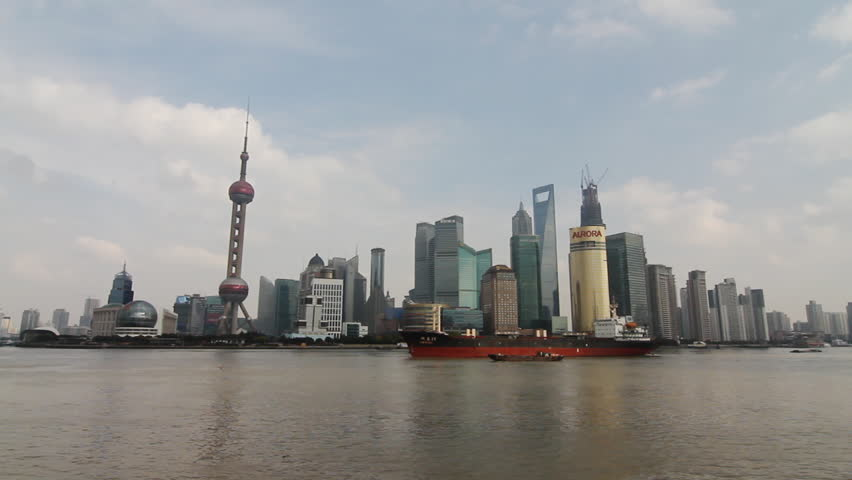 SHANGHAI - DECEMBER 19: Cargo ship and container ship passing in the Huangpu