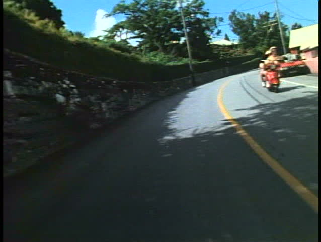POV from moped, motor scooter, winding road in Bermuda