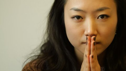 Beautiful young asian woman praying