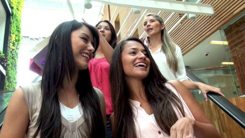Group of happy shopping women at the mall