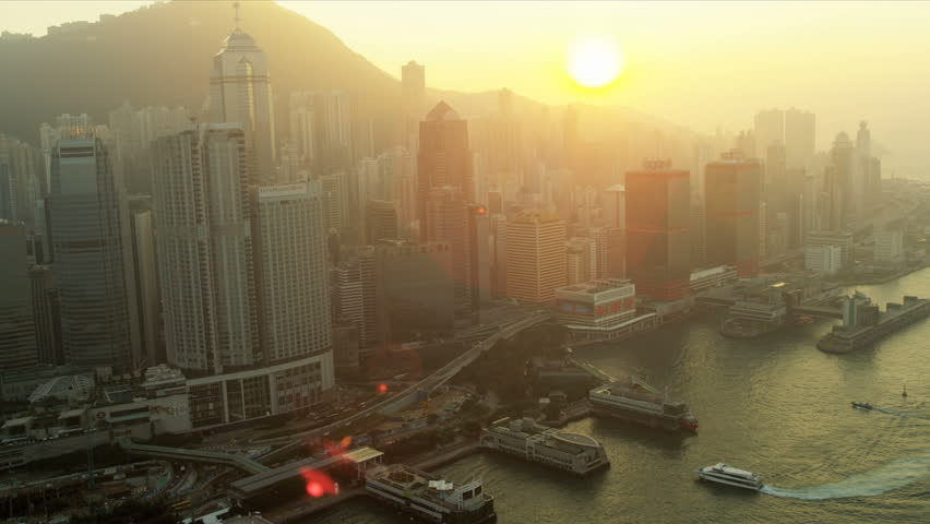 Hong Kong - November 25: Aerial view of Ferry Terminals at sunset over Victoria Peak, Victoria Harbour, Hong Kong, China, Asia, RED EPIC