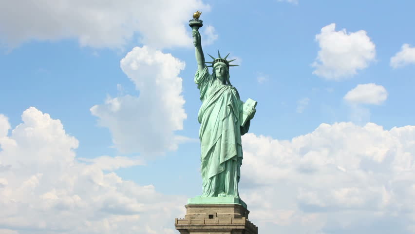 Clouds quickly fly over the Statue liberty