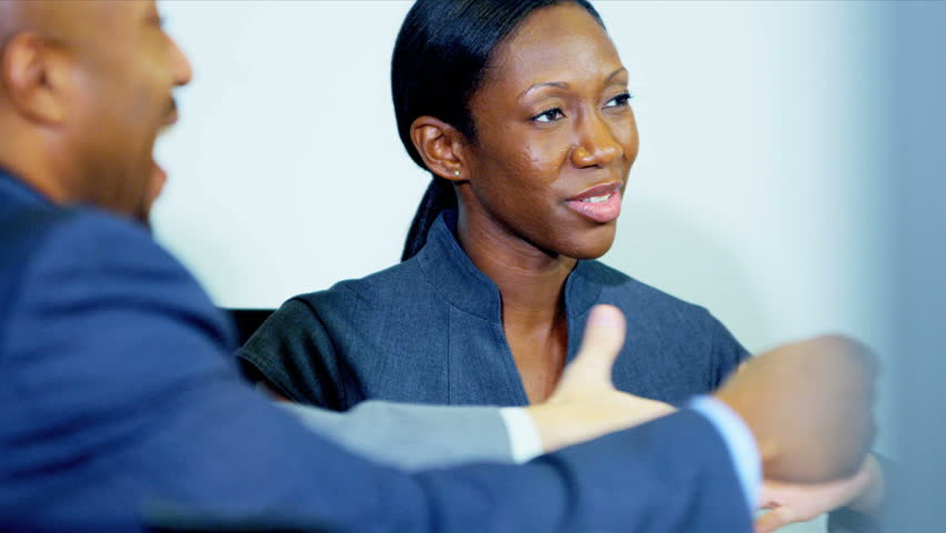 Young Female African American Business Consultant In Client