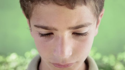 Young people and feelings, portrait of sad young hispanic boy looking at camera
