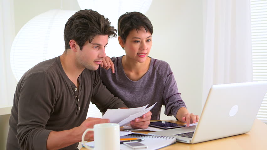 Couple discussing their bills | Shutterstock HD Video #3789221