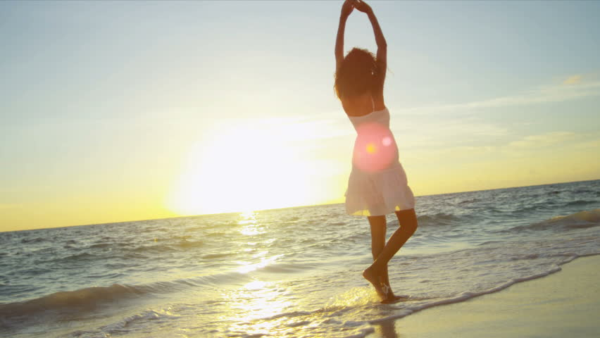 Happy Latin American girl having fun beach on luxury island at sunrise shot on RED EPIC | Shutterstock Video #3789815