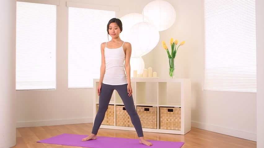Asian woman doing yoga: Chair