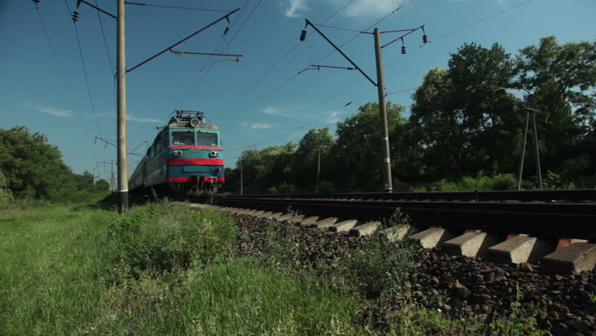 Sunny day. Countryside. Passenger train approaching and passing by