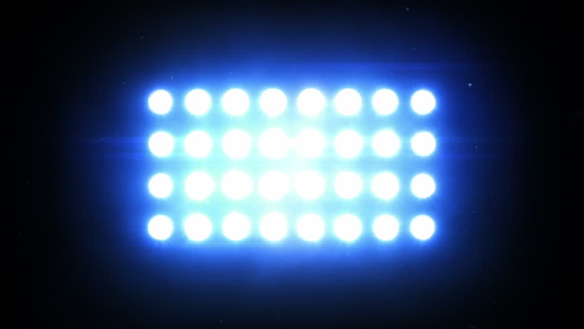 Floodlights. Blue. Bright flood lights flashing.