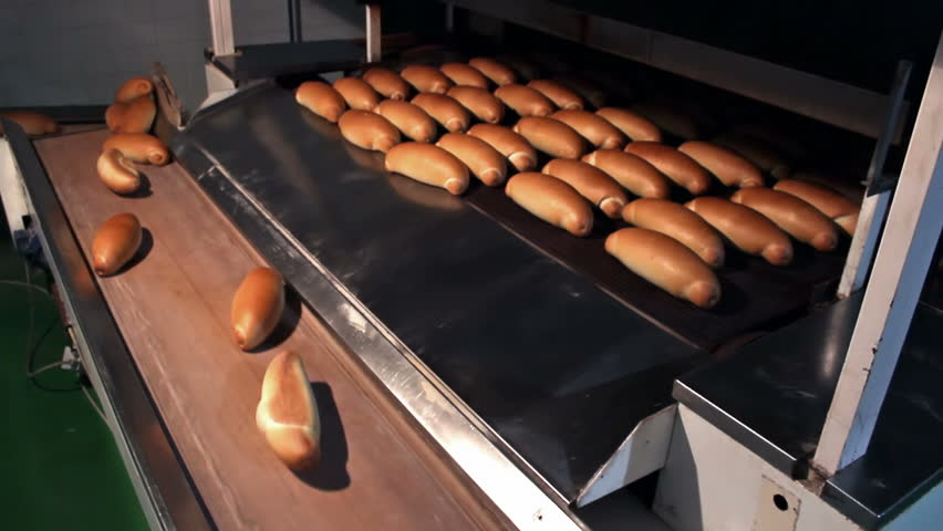 Golden baked bread ; warm baked bread at the exit of the oven,video clip
