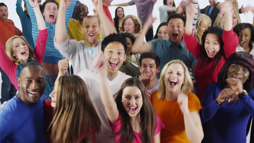 Happy and diverse multi ethnic group of people, in brightly colored casual clothing who are jumping up and down and celebrating an event. They are isolated on white in a studio shot.