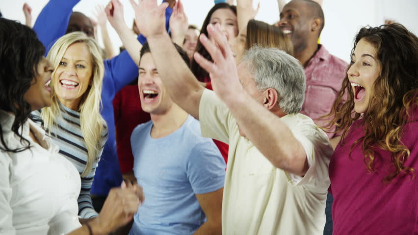 A happy and diverse multi ethnic group of people in colorful casual clothing run towards each other in a long line, cheering and celebrating. Isolated on white in a studio shot. | Shutterstock HD Video #3813926