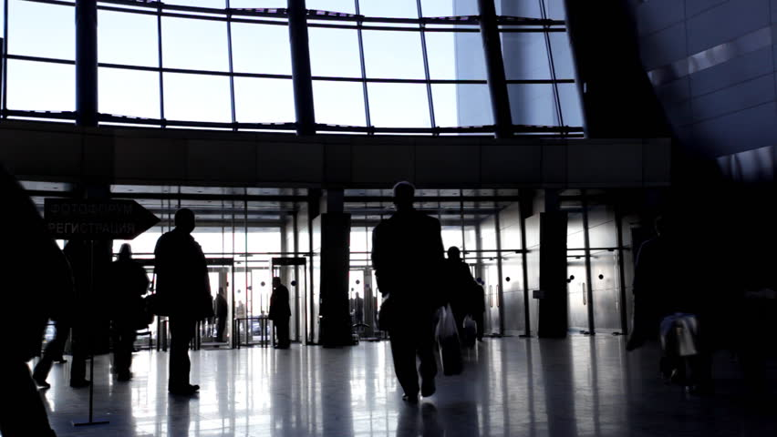 Entrance to modern office building and people silhouettes | Shutterstock HD Video #381436