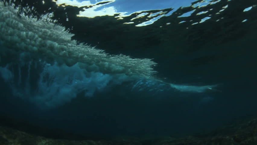 Underwater angle of tropical blue ocean wave  breaking