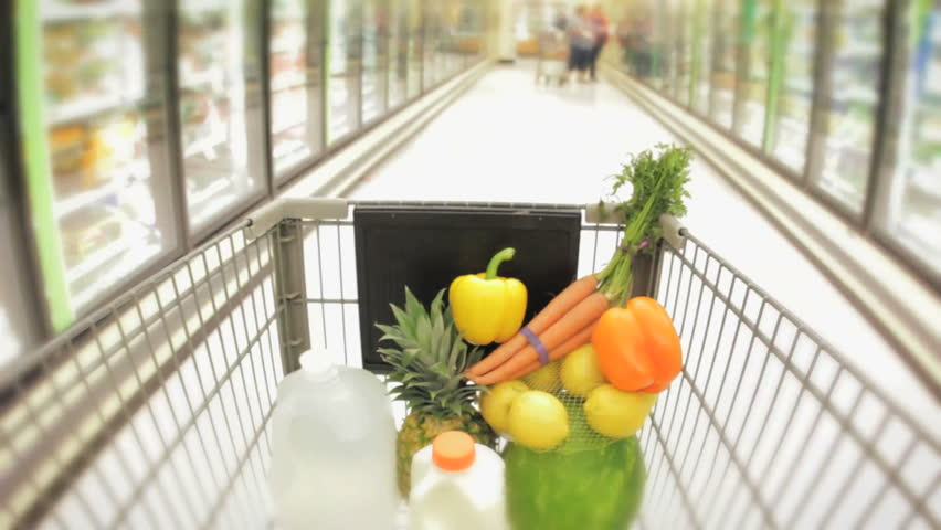 Shopping cart moving through supermarket aisles hidef hd healthy food in the basket