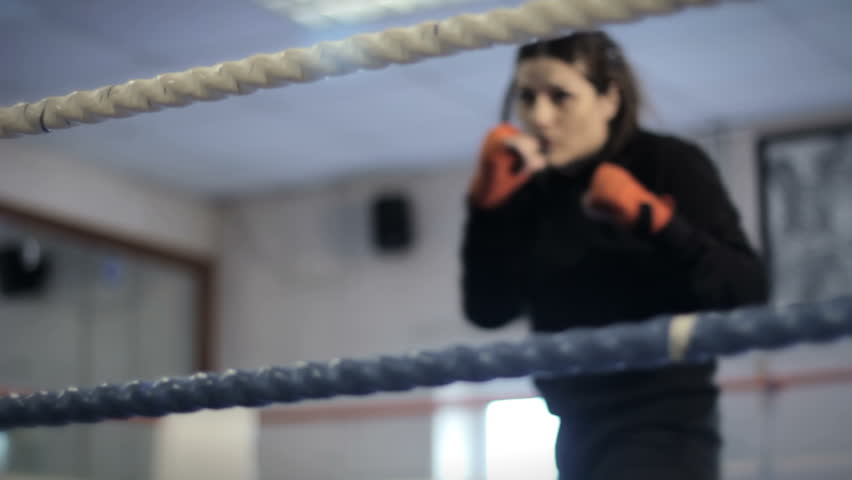 Boxing Ring - a female boxer entering ring and shadow boxing