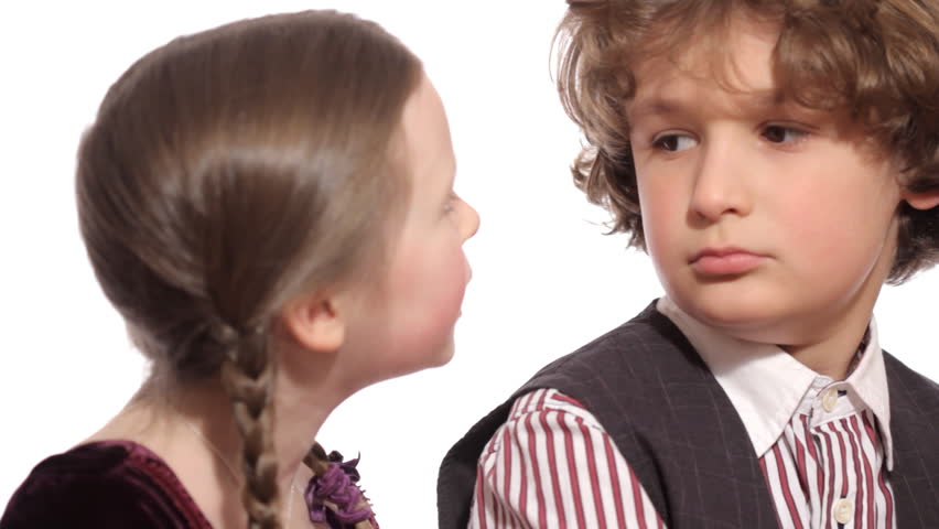 Young Love - A cute little girl kisses a little boy on the cheek, who doesn't know quite what to make of it #3850139