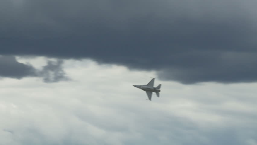 General Dynamics F-16 Fighting Falcon jet fighter in flight.